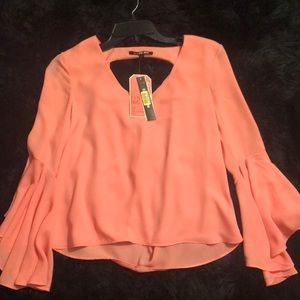 Gianni Bini, it's a peachy kind of color. NEW!